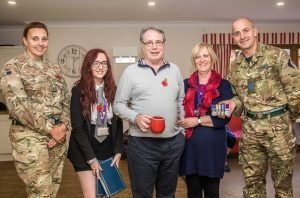 Captain-Becky-Parkinson-and-Staff-Sergeant-David-Tuck-present-Ian-his-daughter-Sophie-and-wife-Wendy-with-his-remounted-medals