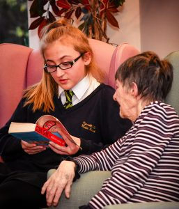 Zara Jackson reads to 82 year old Doreen Bell