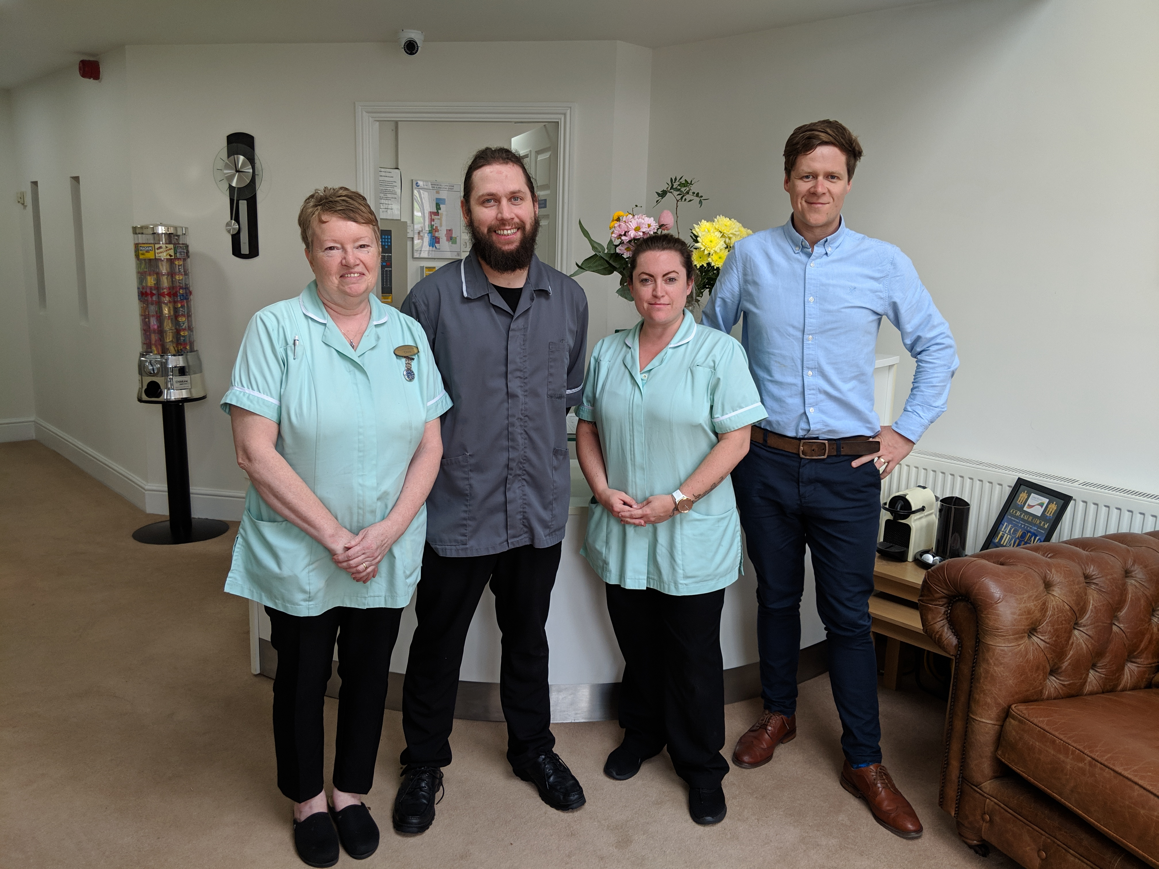 Three long serving staff at Barrowhill Hall pictured with director of MOP Healthcare, Dion Meechan