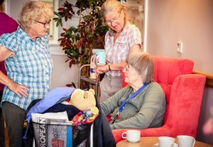 Ramblers chatting to care home resident