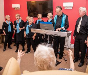A choir performing with keyboard accompaniament