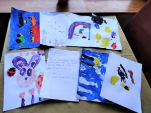 Paintings and messages from children at Dove First School